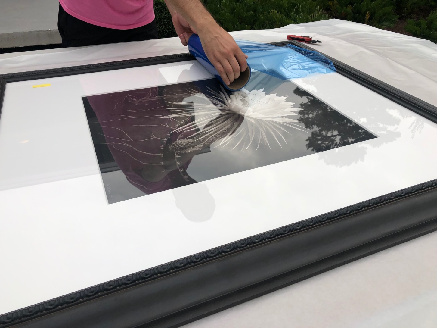 Shipping art framed with glass